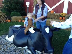 Eli enjoyed riding the cow statue.