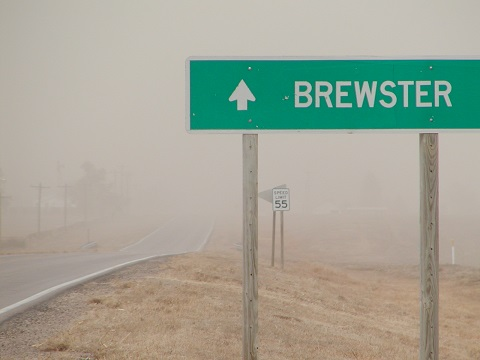 Normally, you can see large grain elevators behind this sign. You'd have to squint hard to see them today.